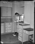 Jean Wilson serves drinks in a kitchen, Los Angeles, 1930s