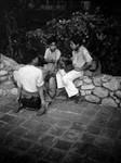 Three boys sitting on rock wall, Olvera Street