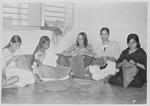 Saidpur, Bangladesh, December 1974. Activation of refugees. Lis Kirsten Dam has started a self, Saidpur, Bangladesh, december 1974. Aktivering af flygtninge. Lis Kirsten Dam har startet et selv-hjælps program for kvinder, som her er igang med håndarbejde. (Lærer Lis Kirsten og arkitekt Niels Anton Dam var udsendt af Dansk Santalmission til Øst Pakistan, 1966-69 samt af Danida til Bangladesh, 1974-77, hvor Niels Anton Dam var leder af stort rehabiliterings-projekt for flygtninge. Her var Lis Kirsten Dam koordinator på et kombineret undervisnings- og beskæftigelsesprojekt for 180 kvinder med ernærings- og sundhedstilbud til deres børn)
