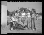 Mrs. Paul Vollandt serving drinks to volunteers who landscaped garden for her disabled husband in El Monte, Calif., 1947