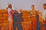 Den Lutherske Kirke/ELCT. Arkitekt og bygmester Karl Emil Lundager inspicerer et af sine byggeprojekter. (Var udsendt af DMS til Bukoba i Nordveststiftet, Tanzania, 1971-93. Karl Lundager blev her ansvarlig for en lang række byggeprojekter, bl.a. Nyakahanga Hospital, Rwantege og Izimbya klinikker samt kirker og præsteboliger i stiftet), Evg. Lutheran Church Tanzania/ELCT. Architect and Building Constructor, Karl Emil Lundager insp