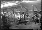 Metal workers loading sheet metal
