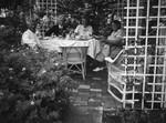 Herman and Ethel Schultheis, garden party at Mrs. Morton's Laguna Beach home