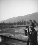 Herman Schultheis with binoculars, Santa Anita Racetrack