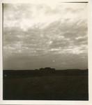 Farm buildings in silhouette