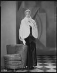 Peggy Hamilton modeling an ermine cape, 1930