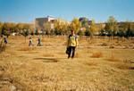 Personalesekretær Eva Madsen foran den bygning i Ulaanbaatar, hvor JCS (Joint Christian Services) havde sit første kontor 1993-1998, Staff Secretary Eva Madsen in Ulaanbaatar, and behind her the building where JCS had its first