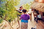 Fra en landsby i Nepal. Lærer Dhan Bahadur Thapa besøger elevernes hjem, From a village in Nepal. Teacher Dhan Bahadur Thapa visiting homes of the pupils