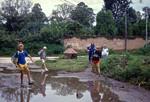 Den Norske Skole i Kathmandu, Nepal, 1991. Vi er på vej til skolens dansklokale, som ligger ca. 50 m fra hovedbygningen. Nu er det regntid, og vi skal passere en kæmpestor vandpyt!, The Norwegian School in Kathmandu, Nepal, 1991. We are walking to the Danish classroom, placed