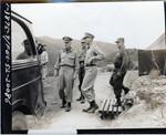 Four generals approaching a car