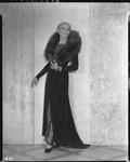 Peggy Hamilton modeling an Earl Luck velvet coat and blue sequin dinner gown, 1931