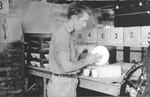 Worker in a ceramics factory