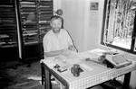 Missionær og lærer, Filip Engsig-Karup på sit kontor, 20. september 1987. Arbejdsopgaver: Leder af undervisning og sociale tiltag i BLM-D og LSS regi. Opgaver som bringer ham i tæt kontakt med den lokale befolkning i området, The Missionary and Teacher, Filip Engsig-Karup at his office, 20th September 1987. Working area