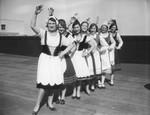 Seven women in folk costumes