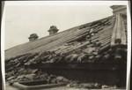 Taifunschaden am Dach; 75 Menschenleben eingebüsst;17/8/36 Hkg; wegen starken Nachwinden konnte der Fotograf (Kaufmann) nur in Kniestellung aufnehmen weil man aufrecht nicht den Apparat stillhalten konnte, Typhoon damage on this roof. 75 people lost their lives. 17. August 1936 in H