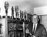 Disney posing with awards