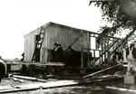Carpenters building a camp building