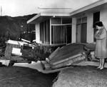 Neighbor examines wrecked home
