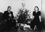 Family around Christmas tree
