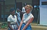 Missionary and Teacher Grete (Ane Margrethe) Jensen, sent by DMS to Tanganyika/Tanzania, 1960-7, Missionær og lærer Grete (Ane Margrethe) Jensen, udsendt af DMS til Tanganyika/Tanzania, 1960-70. Ses her på Kashasha Pigeskole med en lokal lærer