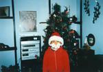Boy dressed as Santa for Christmas