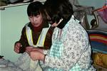 Kindergarden childrens mothers is being taught sewing and weaving to enable them to make a livi, Mødrene til børnene i børnehaven lærer at blive selverhvervene ved vævning