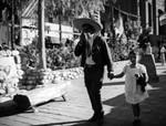 Man and child walking on Olvera Street
