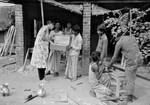 Bangladesh Lutheran Church/BLC, 1991. DSM Missionary Anni Schrøder is assisting evangelists wit, Bangladesh Lutherske Kirke/BLC, 1991. DSM missionær Anni Schrøder hjælper evangelister med trækasser. Kasser, hvor de kan medbringe det, der skal anvendes ved en gudstjeneste