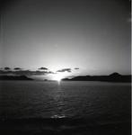 Sunset between islands