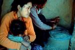 A typical day for women in rural Nepal is like this: After serving tea and khadja she starts wi, Nr. 31 - For landsbykvinder i Nepal ser en typisk dag sådan ud: Efter servering af te og khadja går hun i gang med at male majsmel. Krukken er nemlig ved at være tom. Risen skal også sorteres, og alle de små sten pilles fra