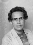 Jordemoder og sygeplejerske, Elly (Jensen) Binderup, (1920 - 2013). Udsendt 1951-82 af Dansk Santalmission til Nordindien, først som distriktsmissionær hos Boro/Bodo-folket i Bongaigaon, Assam. På en ferie traf hun Hazel Platts, og sammen vendte de tilbage til Bongaigaon. Efter 9 år i Assam rejste de til Calcutta for at indgå i det store arbejdsfællesskab omkring St. Pauls Domkirke, som pga. store flygtningeproblemer i området havde startet nødhjælpsarbejde. (Foto fra 1958), Midwife and nurse, Elly (Jensen) Binderup (1920 - 2013). From 1951-82 sent by Danish Santal Mis