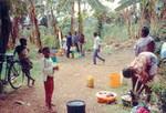 ELCT, Karagwe Diocese, Tanzania. From Nyakahanga Hospital. The hospital staff may use water fro, ELCT, Karagwe Stift, Tanzania. Fra Nyakahanga Hospital. Hospitalspersonale må tage vand på hospitalsgrunden, ellers skal det hentes langt nede i dalen. Foto 1991