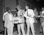 Men holding crates of liquor, Los Angeles, 1955