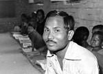 Bangladesh, 1983. The Teacher, Anil Ray giving a lesson at Kamar Sinua village school, Pirganj, Bangladesh, 1983. Undervisning ved lærer Anil Ray i Kamar Sinua landsbyskole, Pirganj kirkedistrikt