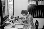 Missionær Bodil Noer Pedersen, udsendt af DSM til BLM-D, Bangladesh, 1985-91 samt 1996-98. Har bl.a. været leder af Saraswatipur Kostskole og ses her på sit kontor, 1991, The Missionary Bodil Noer Pedersen, sent by DSM to BLM-D, Bangladesh, 1985-91 and 1996-98, e.g