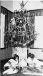 Children around a Christmas tree