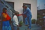 DSM Secretary General and Board member of UMN, Jørgen Nørgaard Pedersen is cutting the ribbon a, DSM generalsekretær og bestyrelsesmedlem i UMN, Jørgen Nørgaard Pedersen klipper snoren ved åbning af et hostel for missionærbørn eller kontor i Kathmandu (?), Nepal april 1983