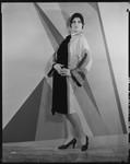 Peggy Hamilton modeling an Adrian coat of black chiffon velvet and cream broadcloth, 1929