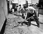 Shoveling up bricks after the quake