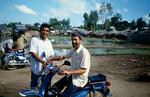 Projectdirector/Missionary Jørgen Lindgaard in conversation with local coworker before visiting, Projektleder/missionær Jørgen Lindgaard samtaler med cambodjansk medarbejder inden han på motorcykel skal besøge et projekt i nærheden af Preah Sdach