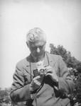 Herman Schultheis checks his camera, Chico