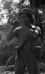 Soldier looking through binoculars, Morazán, 1983