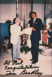 Mayor Bradley gives an award