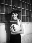 Ethel Schultheis holding magazines