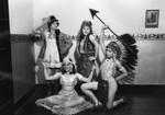 Four dancers in folk costumes