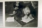 Pupils writing at desks.
