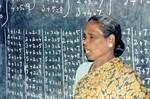 Tamil Nadu, South India. From Siloam Girl's Boarding School, Tirukoilur. National teacher is ex, Tamil Nadu, Sydindien. Fra Siloam Pigekostskole, Tirukoilur. National lærer underviser i regning, 1994
