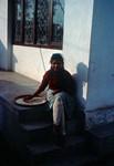 A typical day for women in rural Nepal is like this: After serving tea and khadja she starts wi, Nr. 32 - For landsbykvinder i Nepal ser en typisk dag sådan ud: Efter servering af te og khadja går hun i gang med at male majsmel. Krukken er nemlig ved at være tom. Risen skal også sorteres, og alle de små sten pilles fra