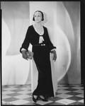 Peggy Hamilton modeling a long dress of chiffon velvet and Alençon lace, 1930