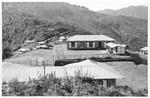 NELC, Assam, Nordindien og Bhutan. Parkijuli Kristne Hospital ligger tæt på grænsen til Bhutan. Hospitalet blev grundlagt af et norsk missionærpar, læge Edel Busch Haugstad og pastor Magnus Haugstad, og udvidet til 75 senge i 1960erne. Mange patienter kom fra Bhutan, hvorfor de ansøgte om og fik kongen af Bhutans tilladelse til at starte sundhedsarbejde inde i landet og bygge et hospital her. Stedet blev Riserboo, hvor grundstenen blev nedlagt i 1967. Hospitalet ses på dette foto med følgende beskrivelse: Dette er Riserboo – Sygehuset i forgrunden. På den anden side af vejen boliger for medarbejdere, og øverst oppe ligger lægeboligen, NELC, Assam, North India and Bhutan. Parkijuli Christian Hospital is placed close to the border